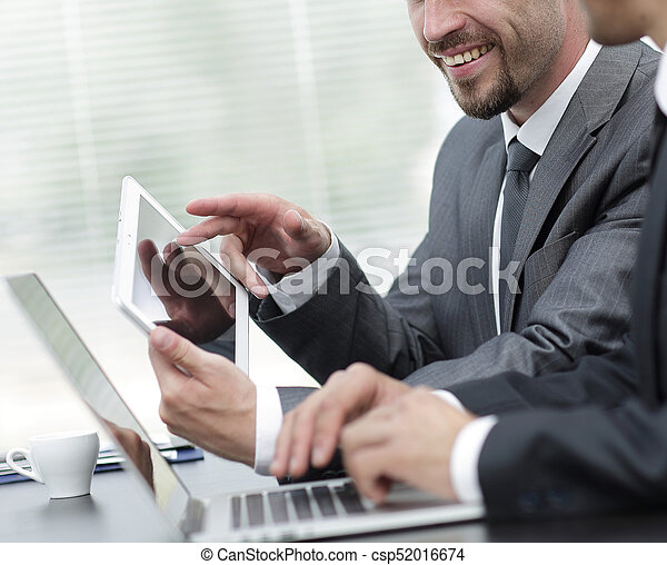 business colleagues working with tablet computer. - csp52016674
