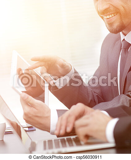 business colleagues working with tablet computer. - csp56030911