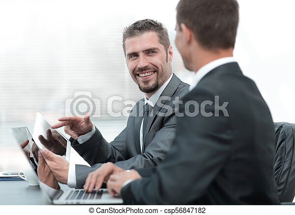 business colleagues working with tablet computer. - csp56847182