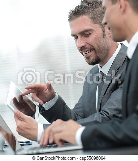business colleagues working with tablet computer. - csp55098064