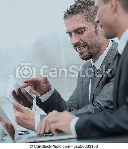 business colleagues working with tablet computer. - csp56803150