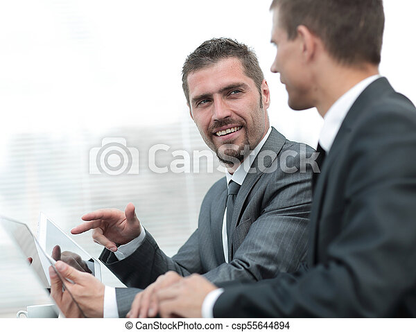 business colleagues working with tablet computer. - csp55644894