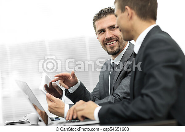 business colleagues working with tablet computer. - csp54651603
