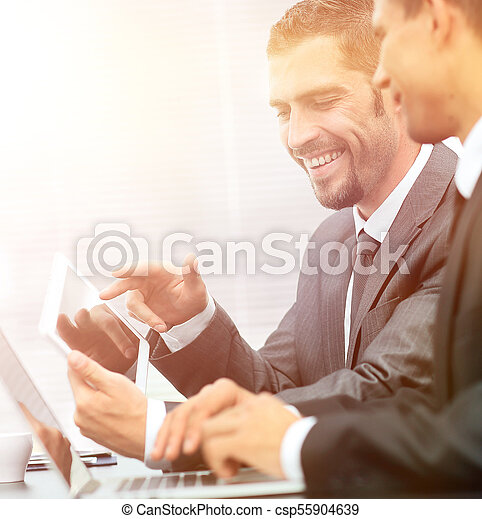 business colleagues working with tablet computer. - csp55904639