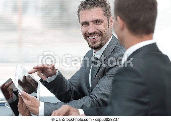 business colleagues working with tablet computer. - csp58829237