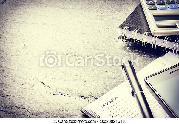 Business concept with agenda, mobile phone and calculator - csp28821618