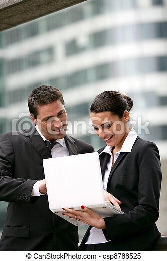 Business couple stood in the city - csp8788525