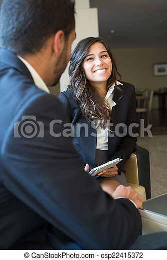 Business couple with tablet - csp22415372