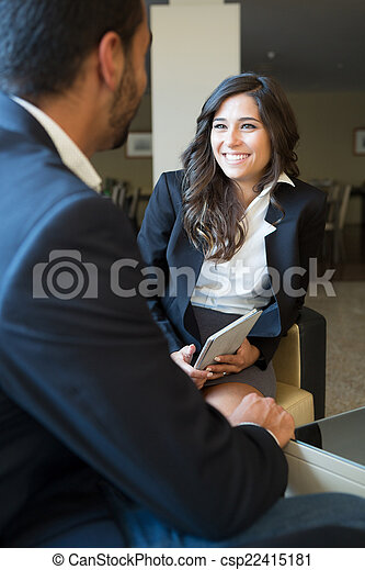 Business couple with tablet - csp22415181