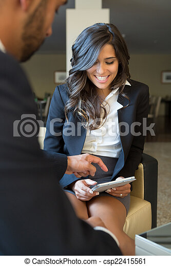 Business couple with tablet - csp22415561