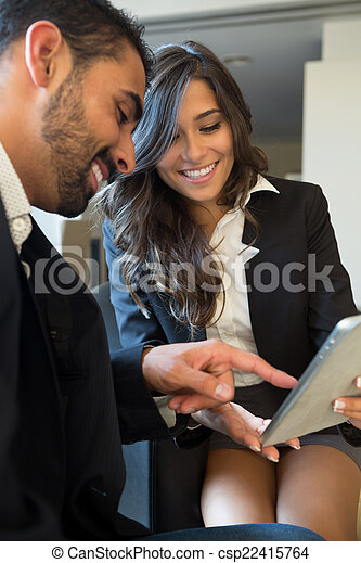 Business couple with tablet - csp22415764