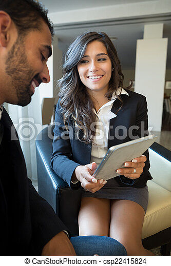 Business couple with tablet - csp22415824