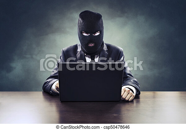 Business espionage hacker or government agent stealing secrets - csp50478646