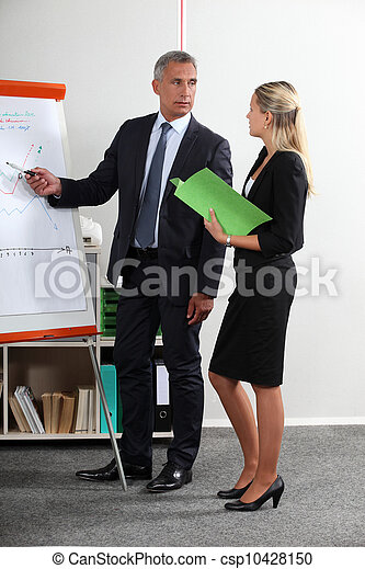 Business executives standing at a white board - csp10428150