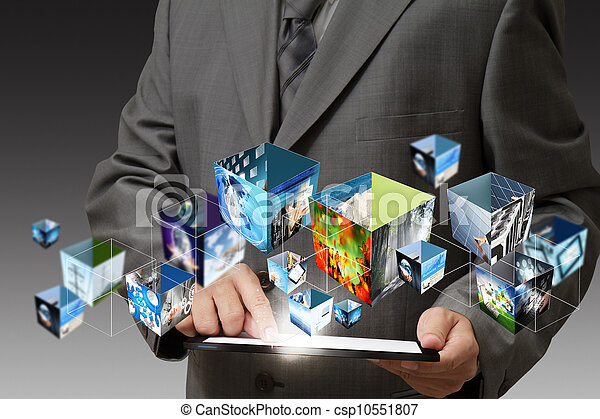 business hand holding a touch pad computer and 3d streaming images - csp10551807