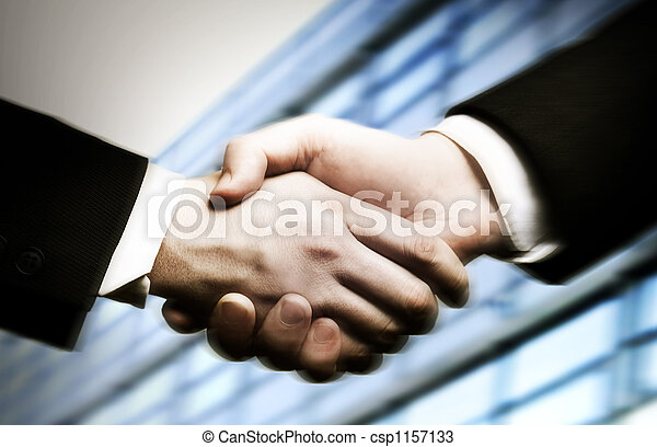 business hand shake and a office in background - csp1157133