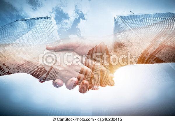 Business handshake over modern skyscrapers, double exposure. - csp46280415