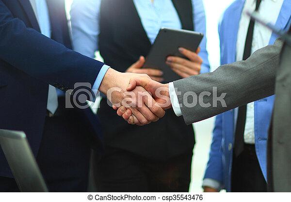 Business handshake - csp35543476