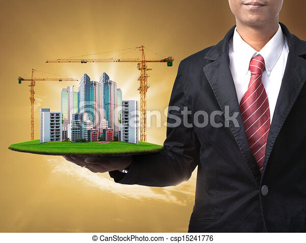 business man and building construct - csp15241776