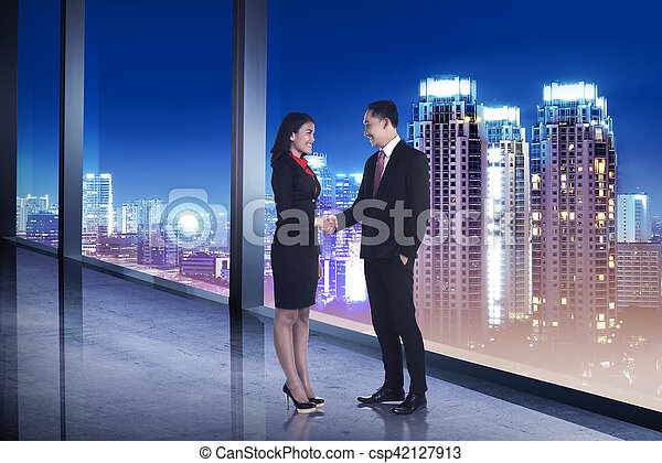 Business man and woman shaking hand - csp42127913