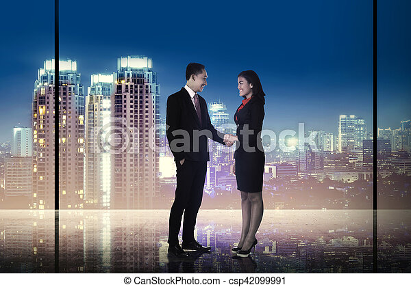 Business man and woman shaking hand - csp42099991