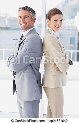 Business man and woman smiling - csp21871642