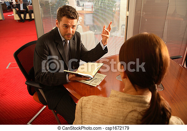 Business man and woman talking in the office - csp1672179