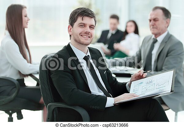 business man at office with his business team working behind - csp63213666