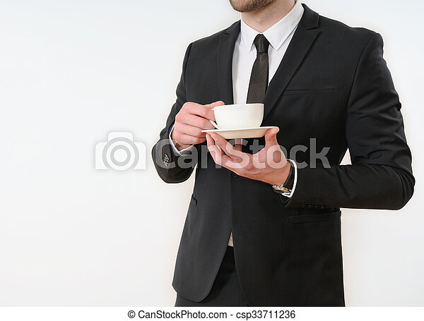 business man body side in black suit with cup of coffee on white background - csp33711236