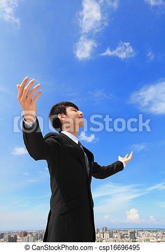 business man carefree outstretched arms with sky and cloud asian