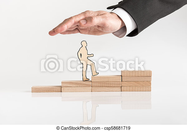 Business man climbing the steps to success - csp58681719