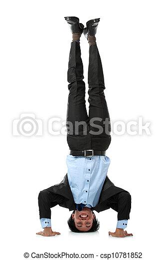 business man doing handstand full length of business man