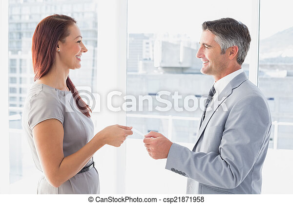 Business man giving his card - csp21871958