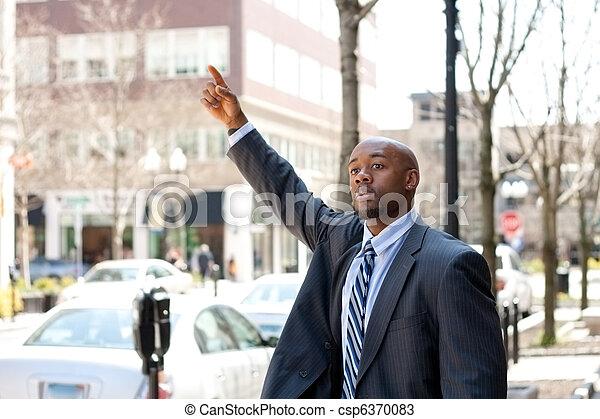 Business Man Hailing a Taxi Cab - csp6370083