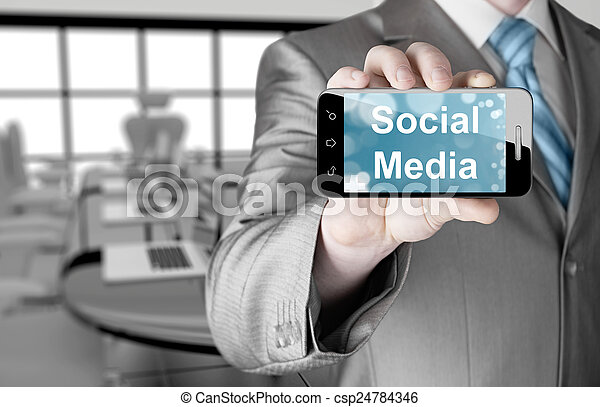 business man hand holding smartphone with Socail Media - csp24784346