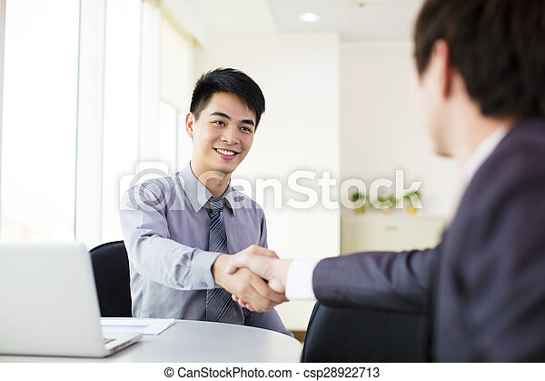 business man hand shaking in office - csp28922713