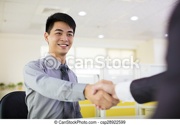 business man hand shaking in office - csp28922599