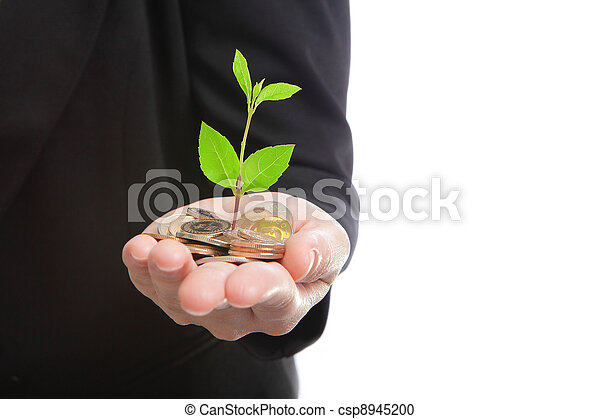 business man hand with green plant growing from money - csp8945200