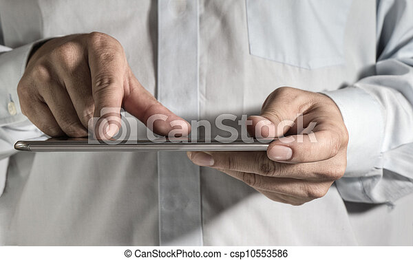 business man hand working on a digital tablet - csp10553586