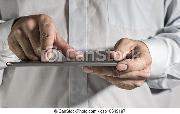 business man hand working on a digital tablet - csp10643197