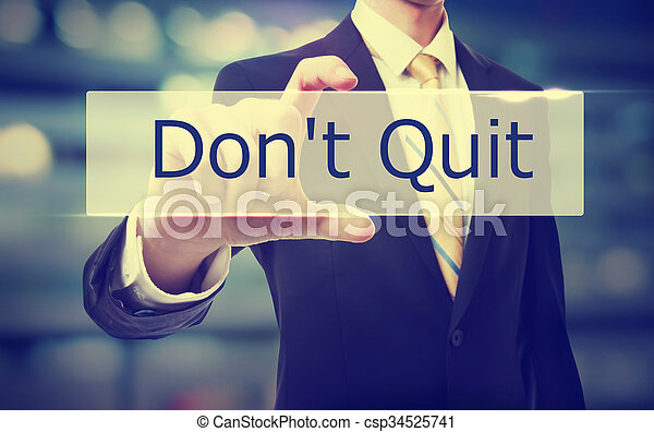 Business man holding Don't Quit - csp34525741