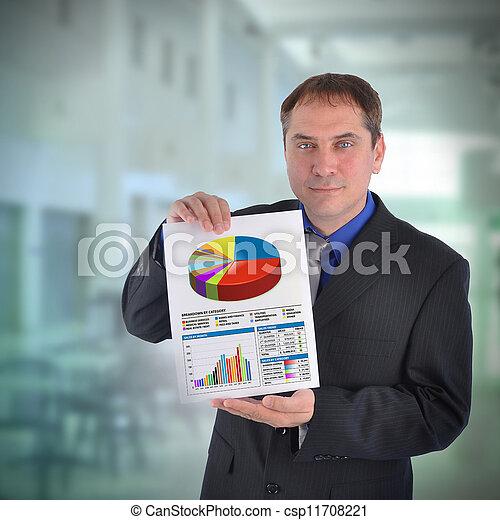 Business Man Holding Graph Chart - csp11708221