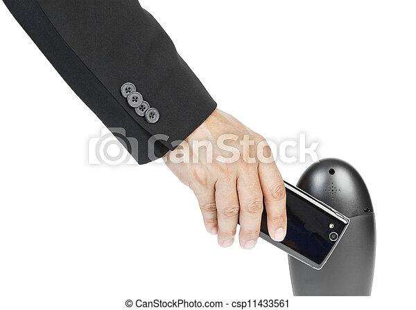 business man holding smartphone as NFC - Near field communication concept - csp11433561