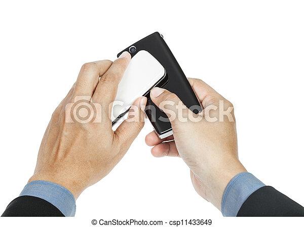 business man holding smartphone as NFC - Near field communication concept - csp11433649
