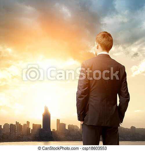 business man look sunrise in the city - csp18603553