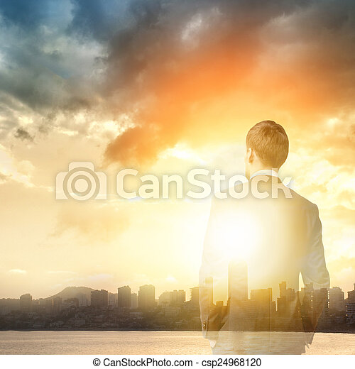 business man look sunrise in the city - csp24968120