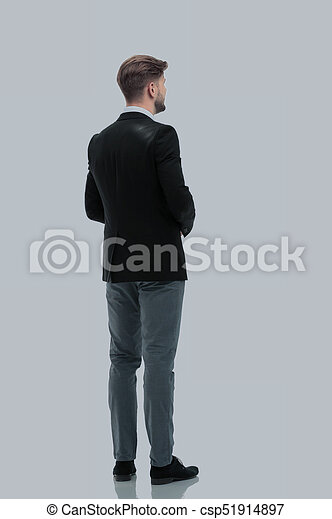 Business man looking at something  isolated on white background - csp51914897