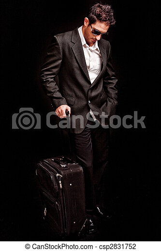 Business man looking down with his luggage - csp2831752