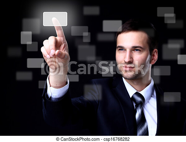 business man pressing a touchscreen button on dark background - csp16768282