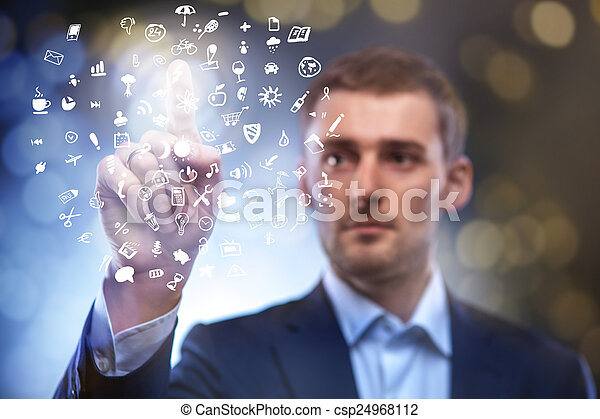 business man pressing button with set of icons in air - csp24968112